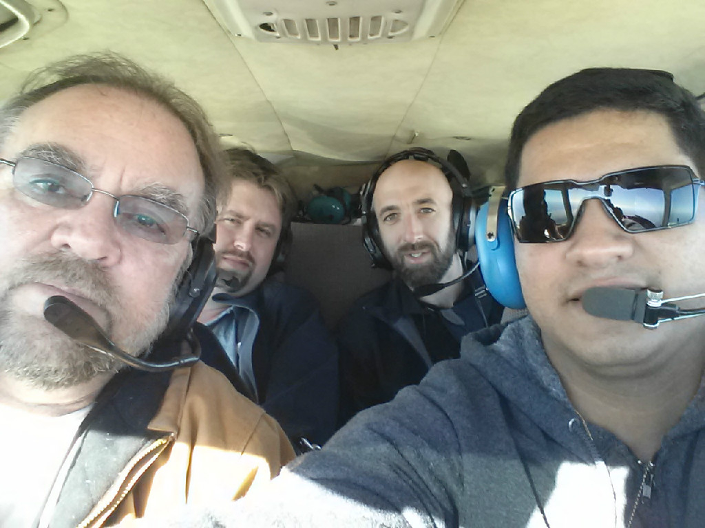 Four people inside an aircraft.