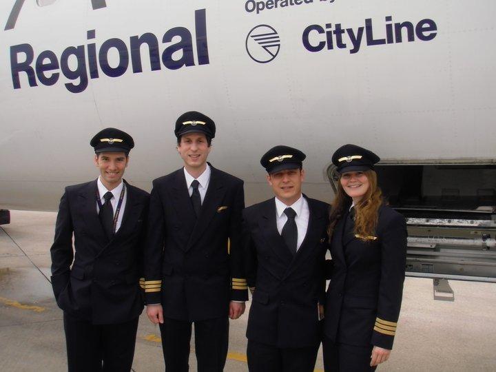 Four pilots in uniform.