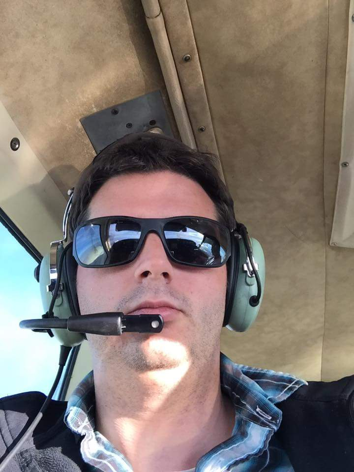 Selfie of a man flying an airplane.