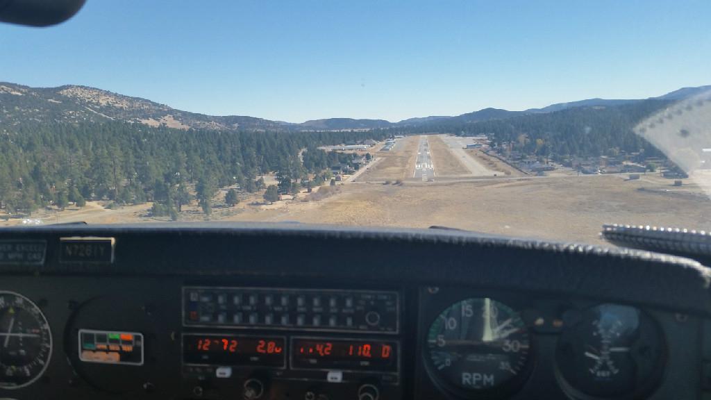 Plane preparing to land on the runway.