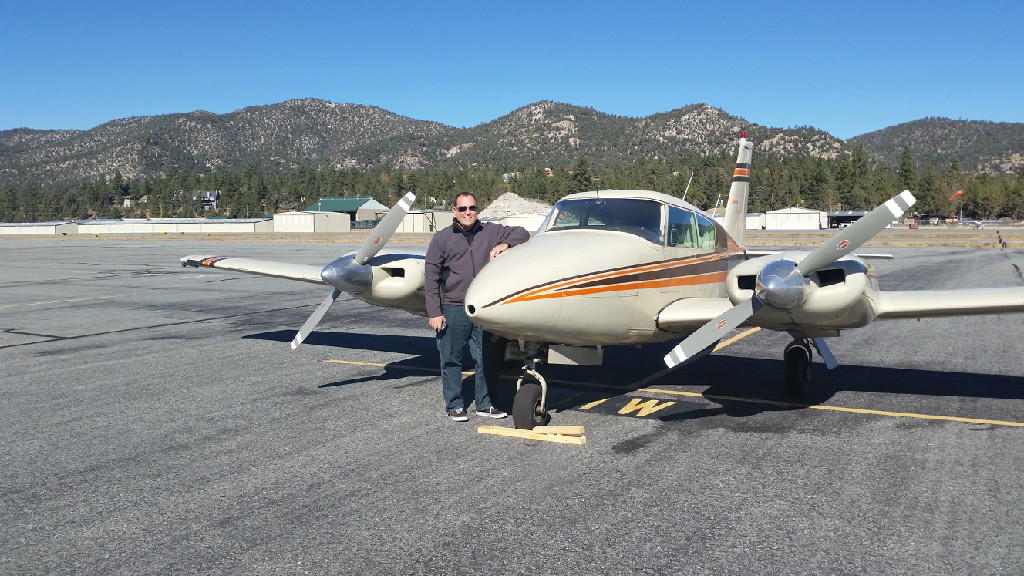 Man beside a plane on the runway.