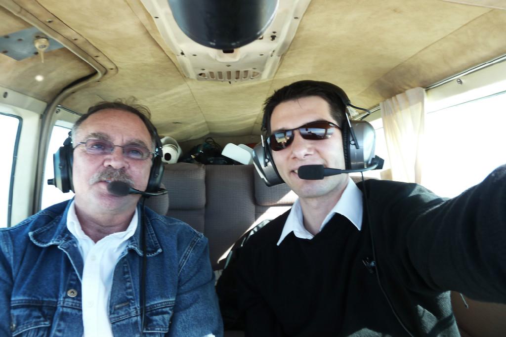Selfie of two people inside the plane.