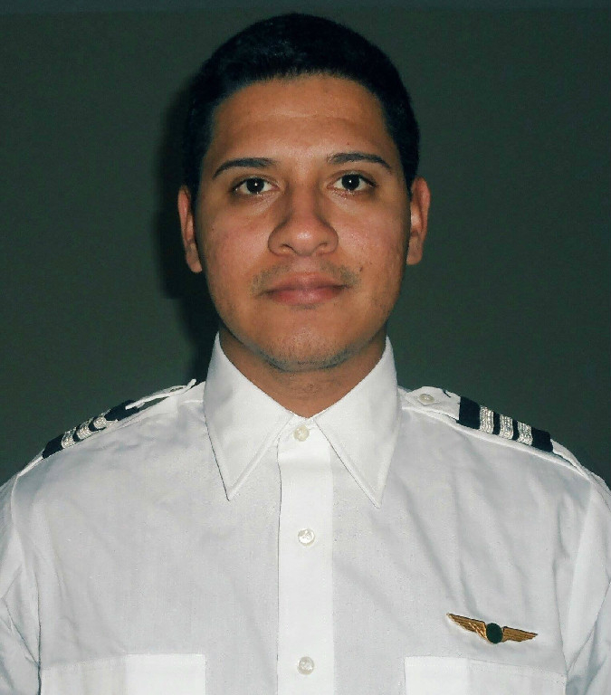 A pilot in uniform.
