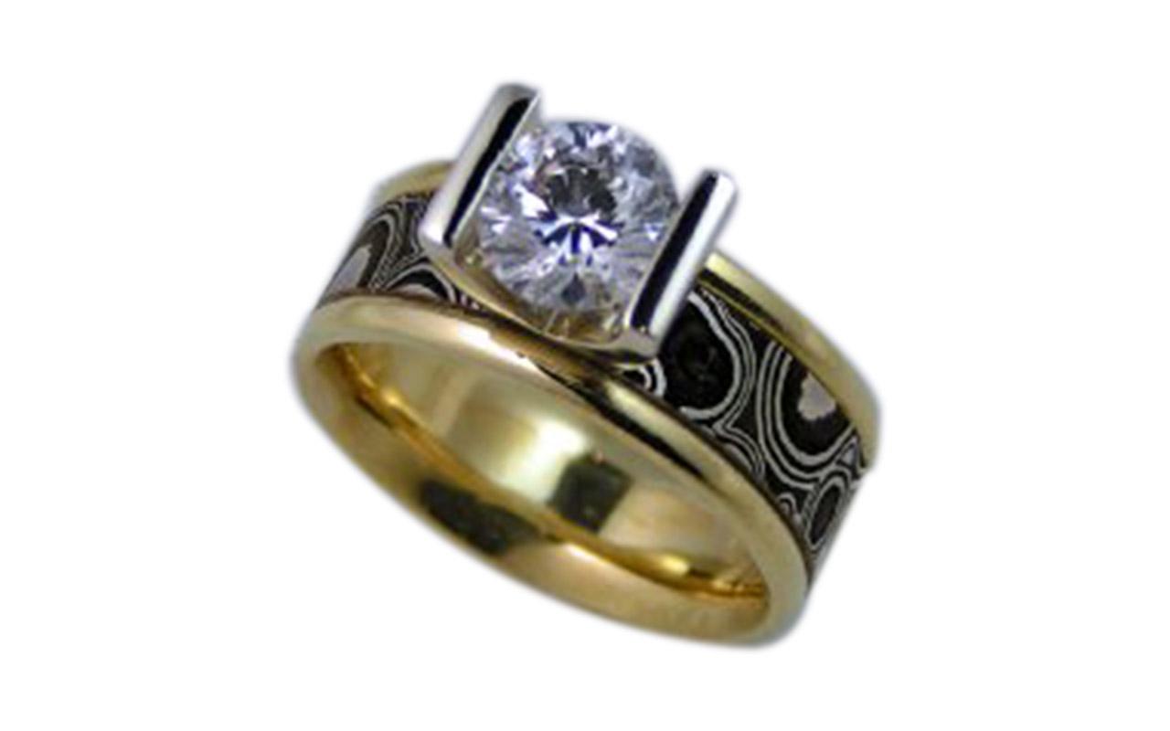 Mokume gane 18 kt yellow gold 1.00 ct diamond.<br /> Mokume-gane ( 木目金 ) is a mixed-metal laminate with distinctive layered patterns.