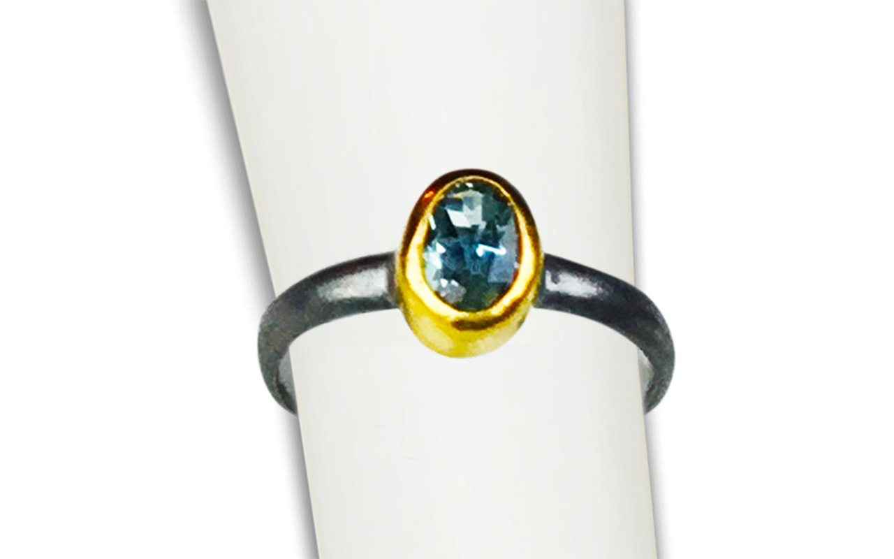 Soothing, Healing BlueTopaz - set in 22kt gold and heavy black oxidized silver.