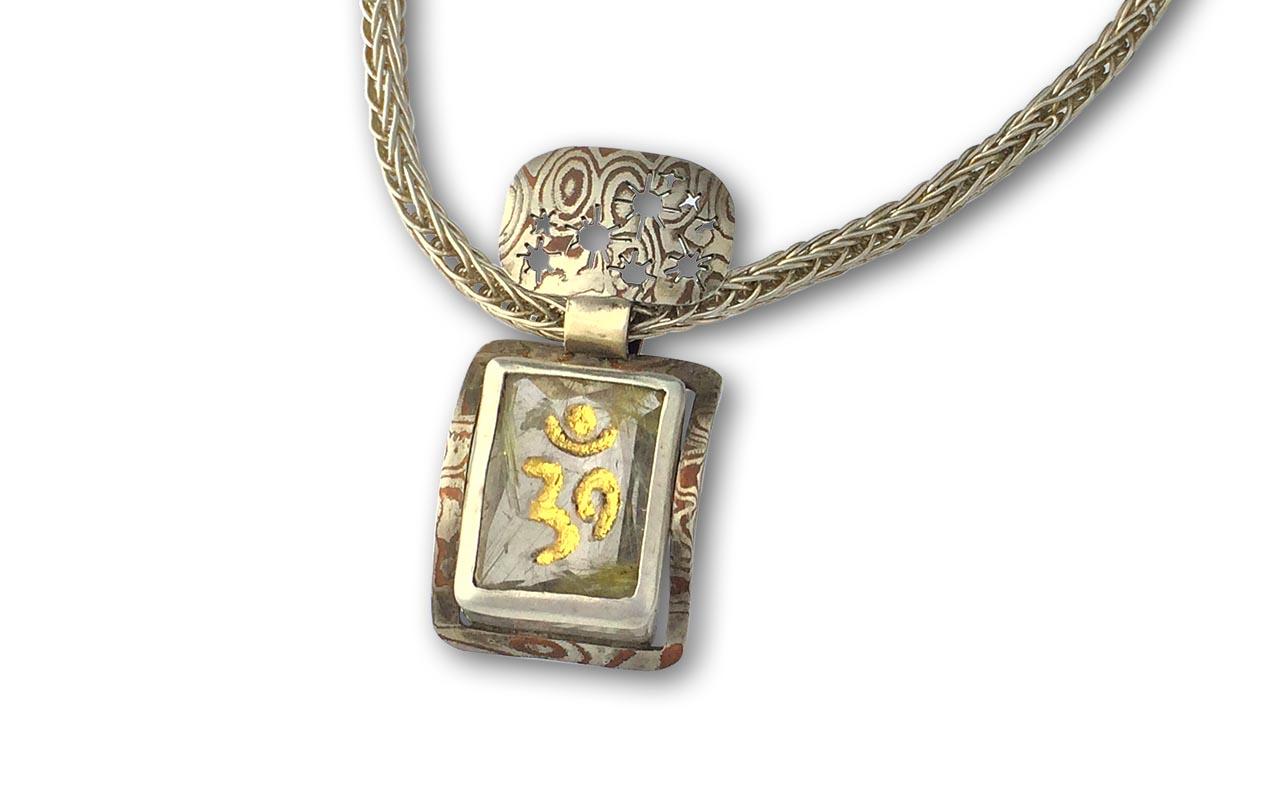 The Pleiades Constellation - Om symbol etched into quartz gemstone in 24kt gold. Pleiades Constellation cut in Mokume-gane ( 木目金 ),