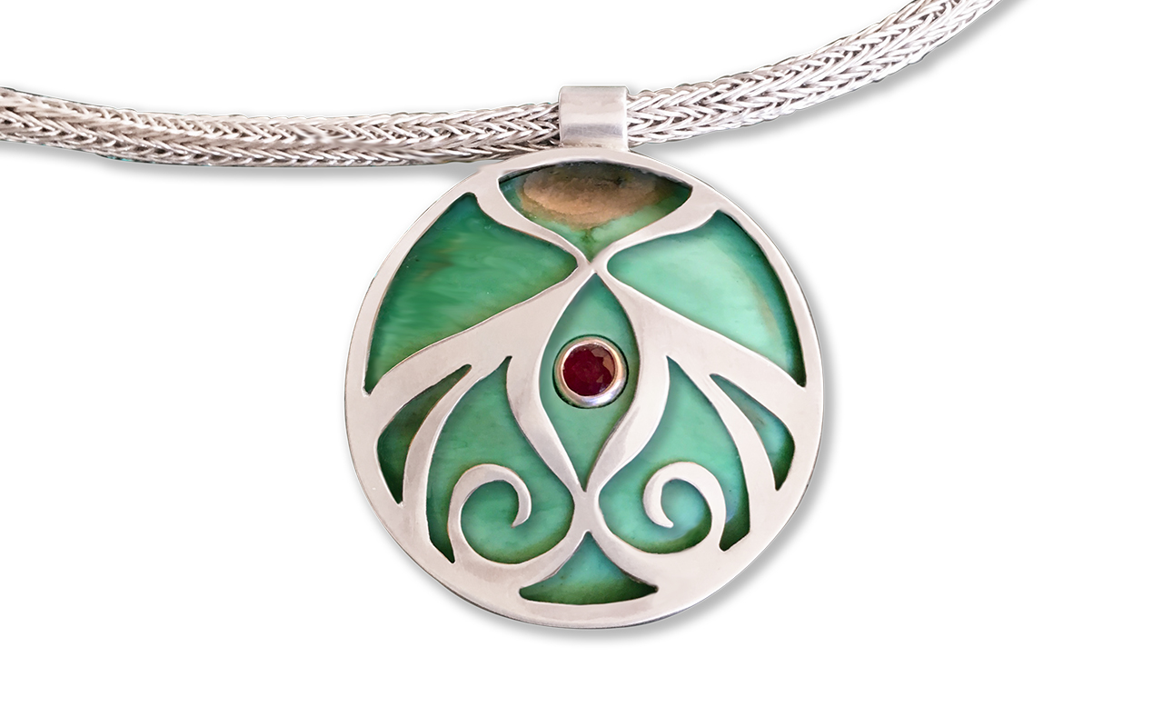 Inside a Woman is the Portal of the Universe - Sterling Silver, vericite and Garnet, with hand woven 5 row chain.