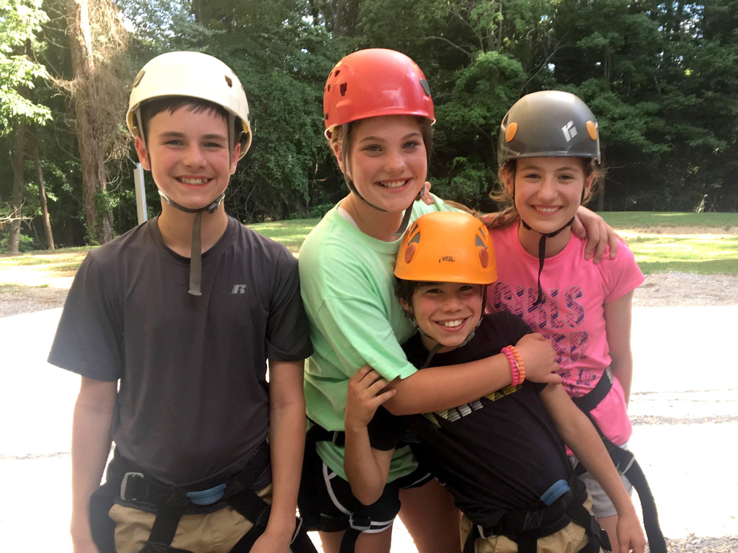 friends at camp in safety helmets