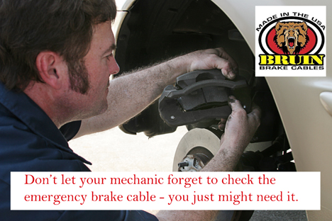 Mechanic Inserting Brake Pad