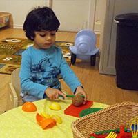 A child playing kitchen