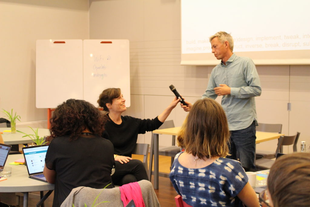 Moderator handing over the microphone to Sara Hendren at a 2018 event at KTH, Stockholm. Photo credit: Francesca Albrezzi.