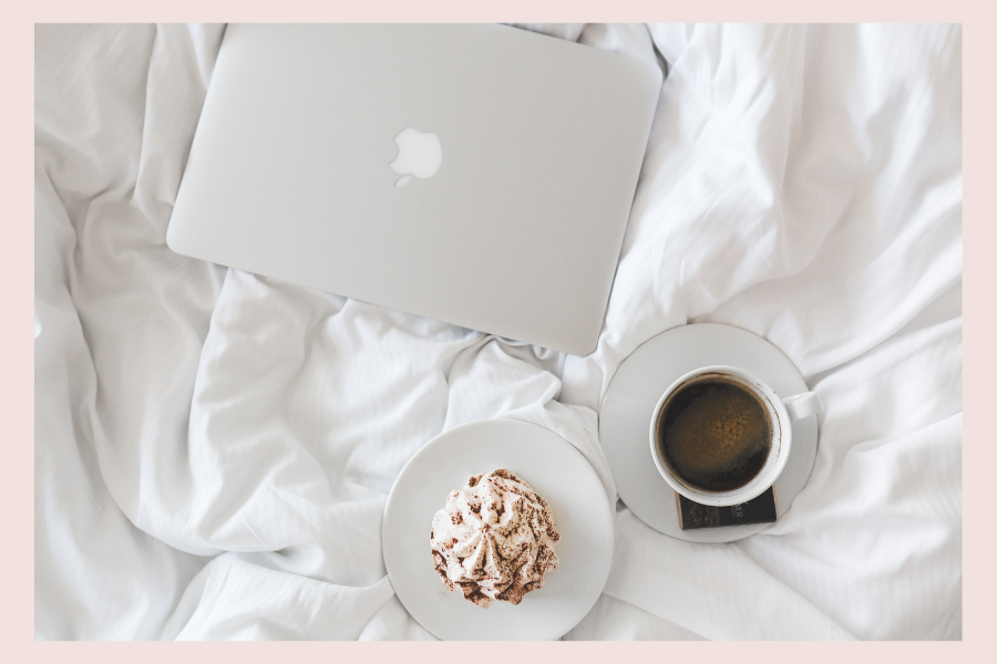 Working from home , in bed with a muffin and tea