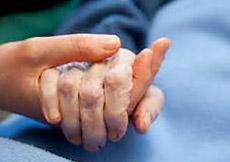 senior citizen holding hands