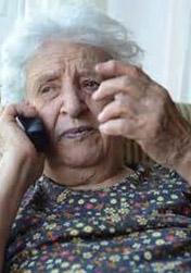 senior citizen at nursing home on phone