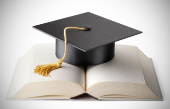 A mortarboard and book demonstrate the success of higher ed recruitment.