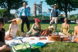 A group of people having a picnic in Smale Riverfront Park