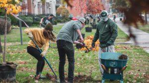 MadTree Brewing employees planting trees in Cincinnati Parks Laurel Park