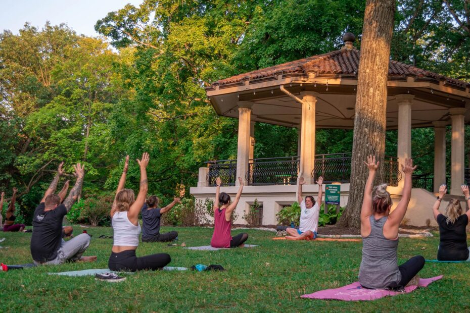 A group of people doing yoga at the Burnet Woods Bandstand