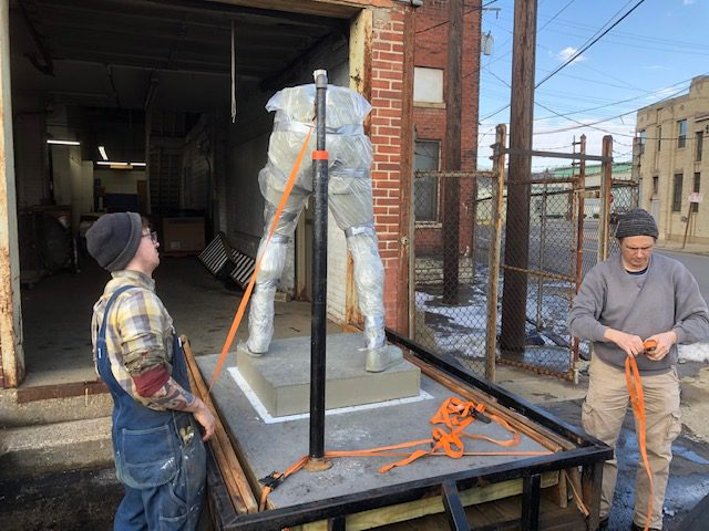 Ezzard statue being moved