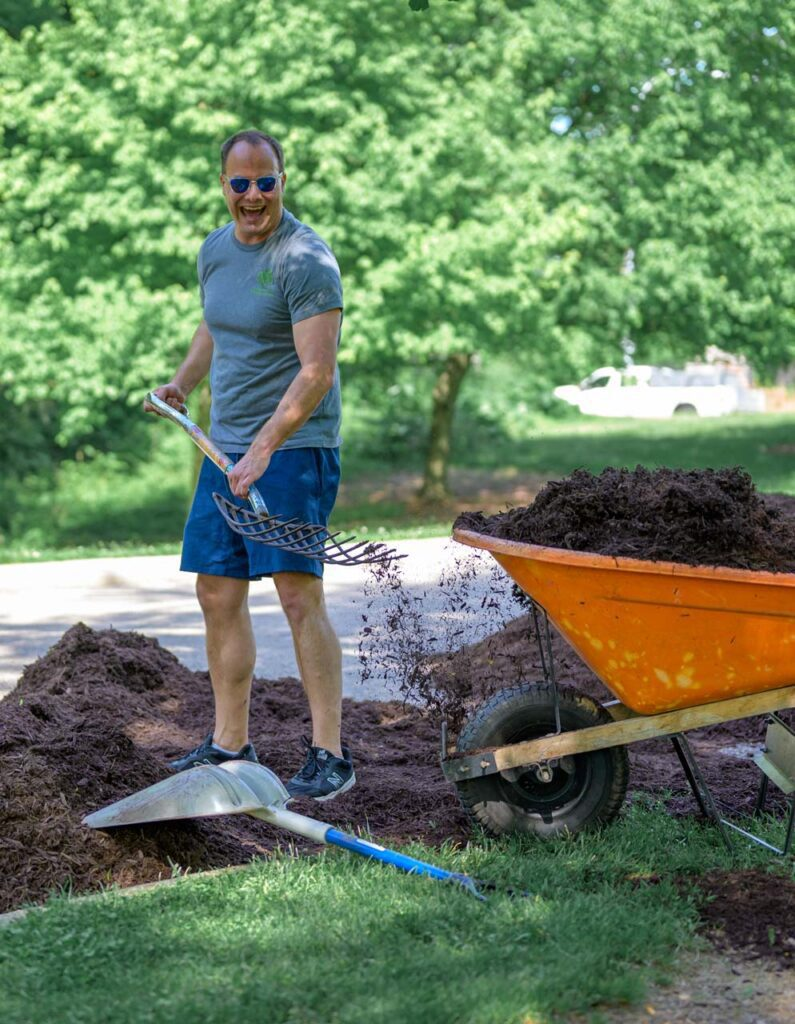 Foundation Board member at the Mayor's Corporate Challenge shoveling mulch