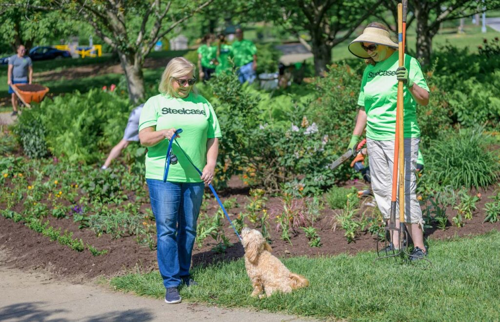 Steelcase volunteers at Eden Park planting flowers