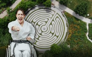 Person in a wheelchair does karate at the Smale Riverfront Park labyrinth