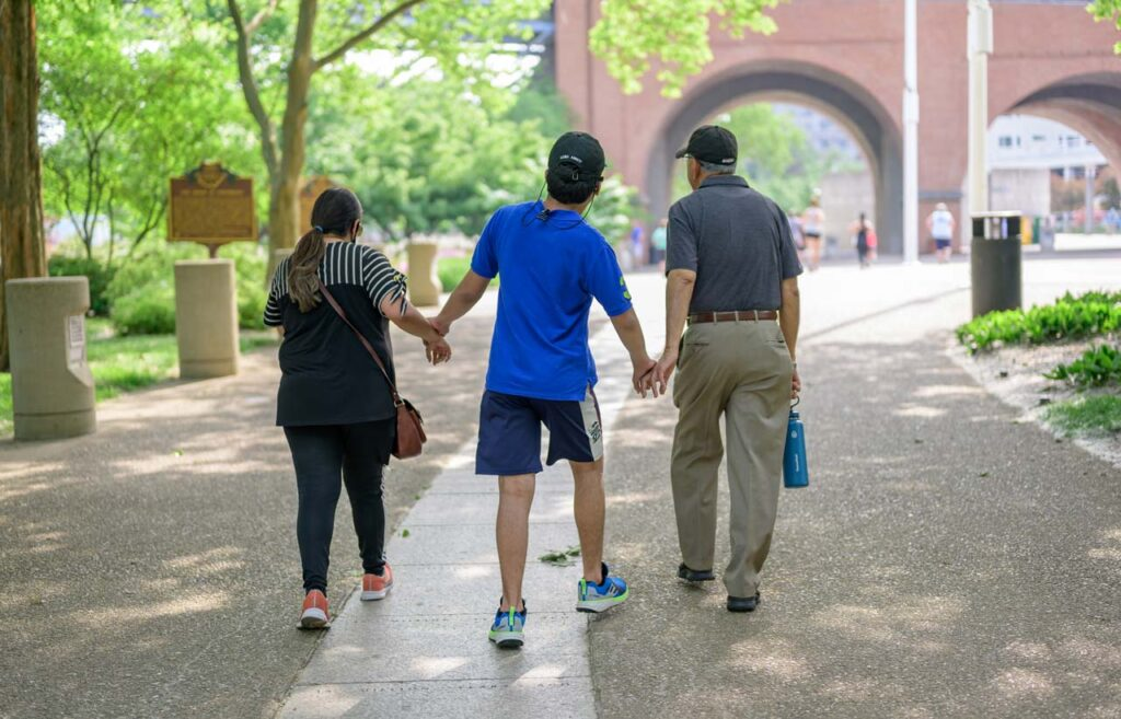 A family walks through Cincinnati Parks in the be.well Move Program