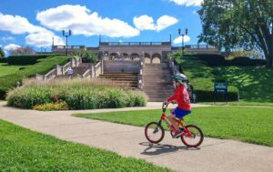 A boy riding his bike in Ault Park in celebration of the CROWN Cincinnati trail