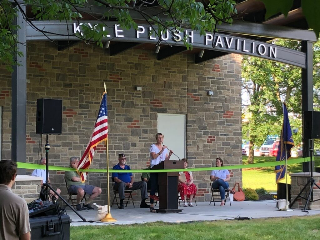 Jennifer Spieser speaking at the ribbon cutting of the Kyle Plush Pavilion in Stanbery Park.