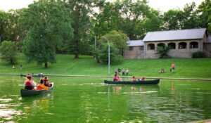 People Canoeing in Rapid Run Park for Canoe and Movie night