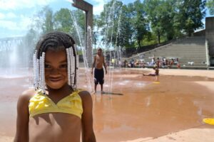 Children enjoying the Armeleder Memorial Sprayground at Sawyer Point