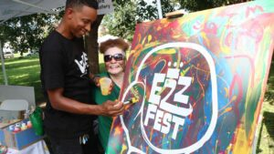 Two people at Ezz Fest in laurel park