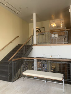 A photo from inside of the firm. Picture is taken from directly inside the backdoor of the building. Kimball Anderson is located the stairs on the second floor.