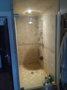 travertine shower stall by Terrazzo Creations Inc
