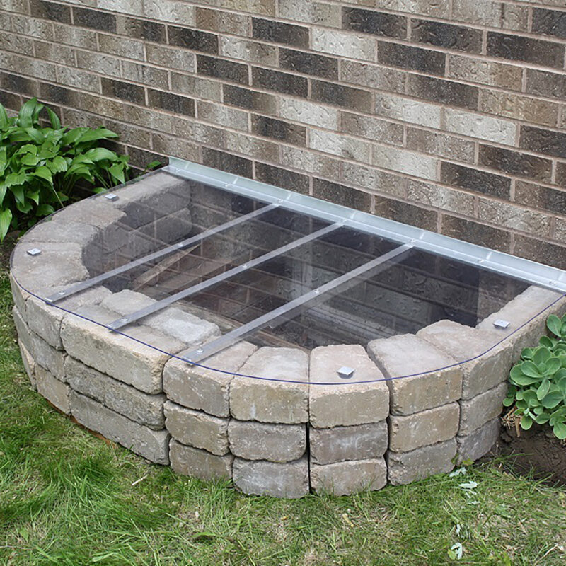 Custom window well cover by shape products installed on a basement window well