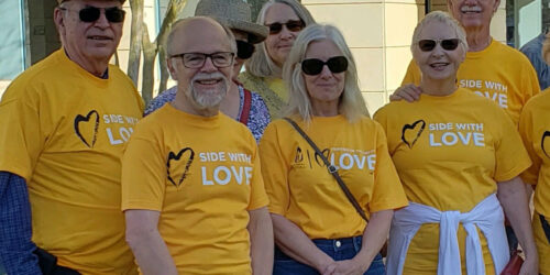 """six people wearing """"side with love"""" tshirts"""