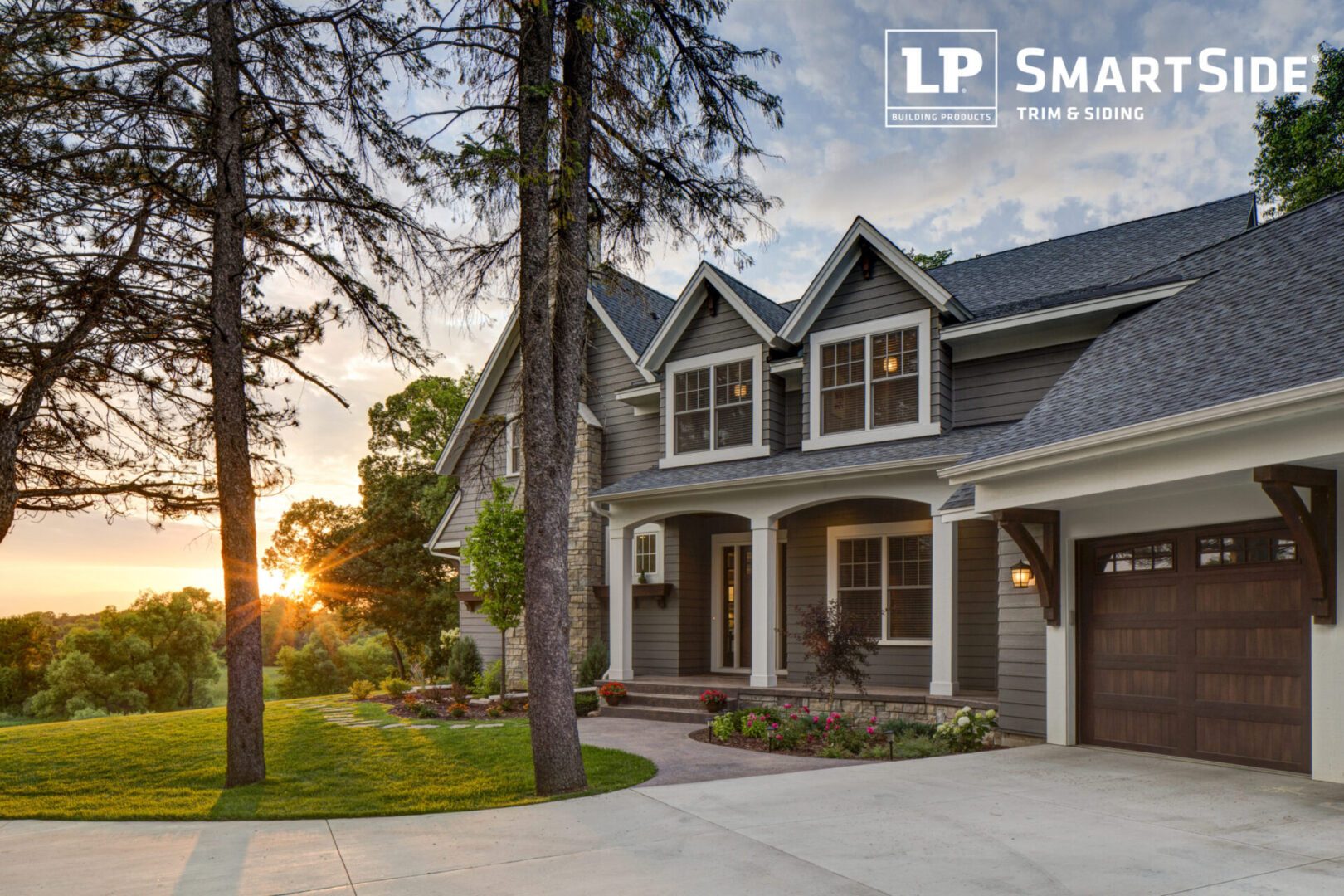LP_Assets_HighRes High res - grey house with white trim, large fir trees, sunset - DOWNLOAD OR SHARE