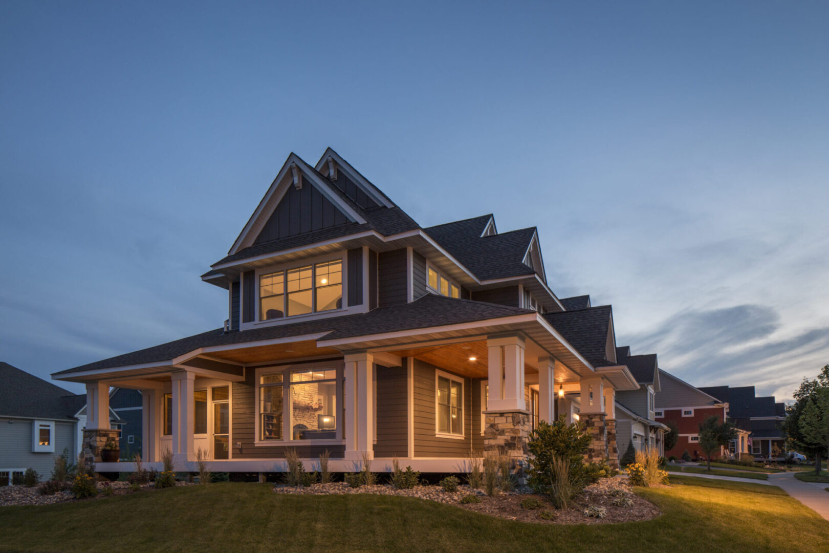 LP_Assets_HighRes High res - grey house with large porch, night view 2 - DOWNLOAD OR SHARE