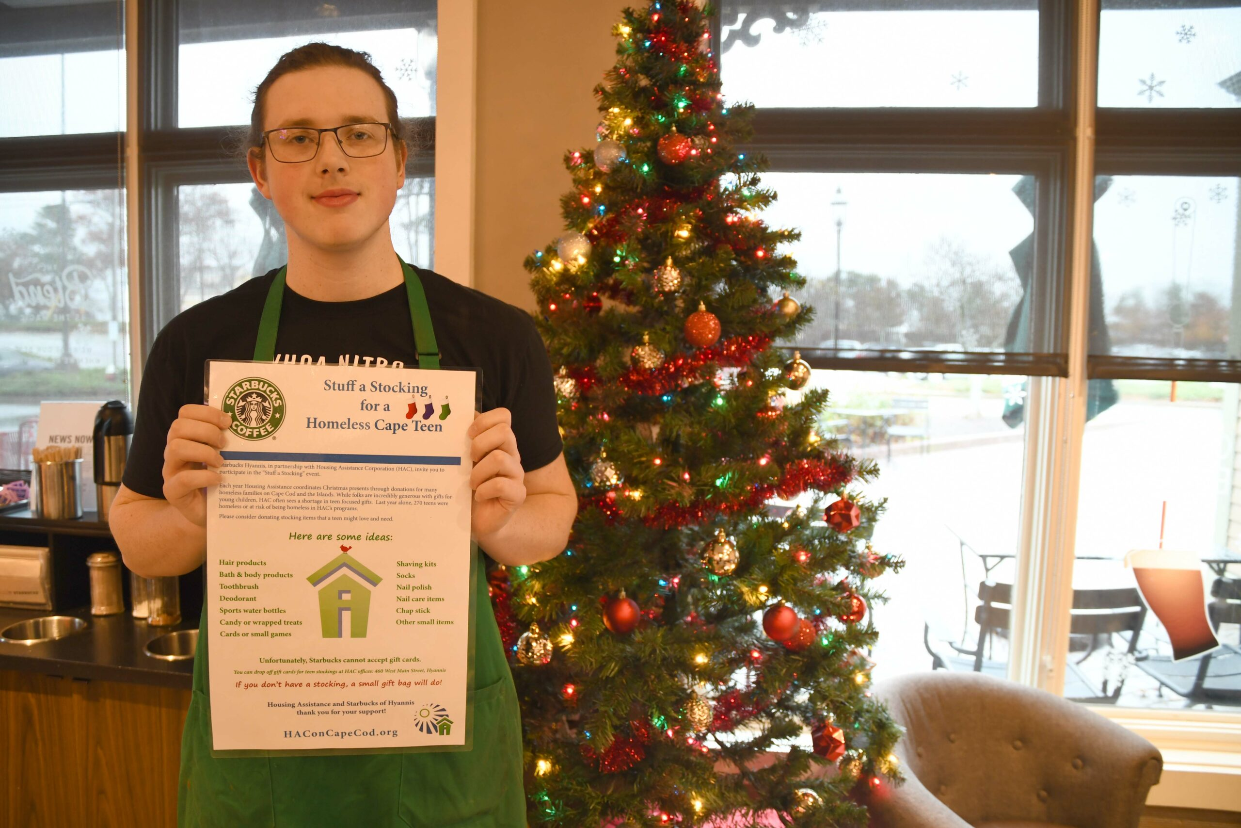 Photo of employee at Starbucks in Hyannis which is collecting stockings for homeless or at-risk homeless teens.