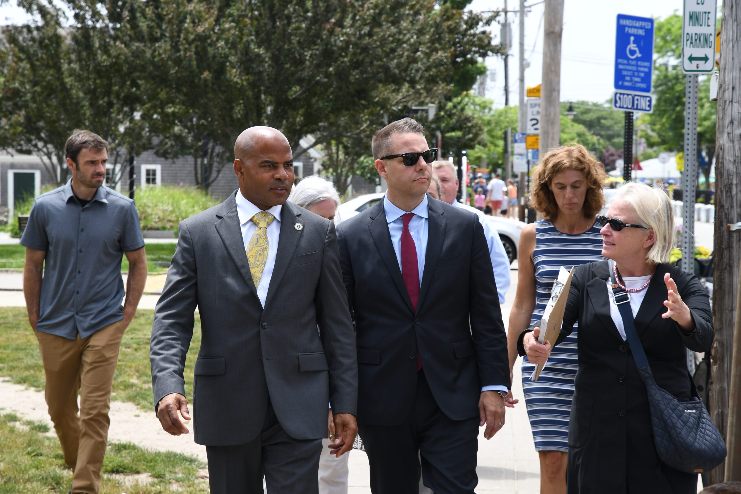 Elizabeth Wurfbain of the Hyannis Main Street Business Improvement District leads State Representative Kip Diggs and James Arciero on a tour of downtown Hyannis.