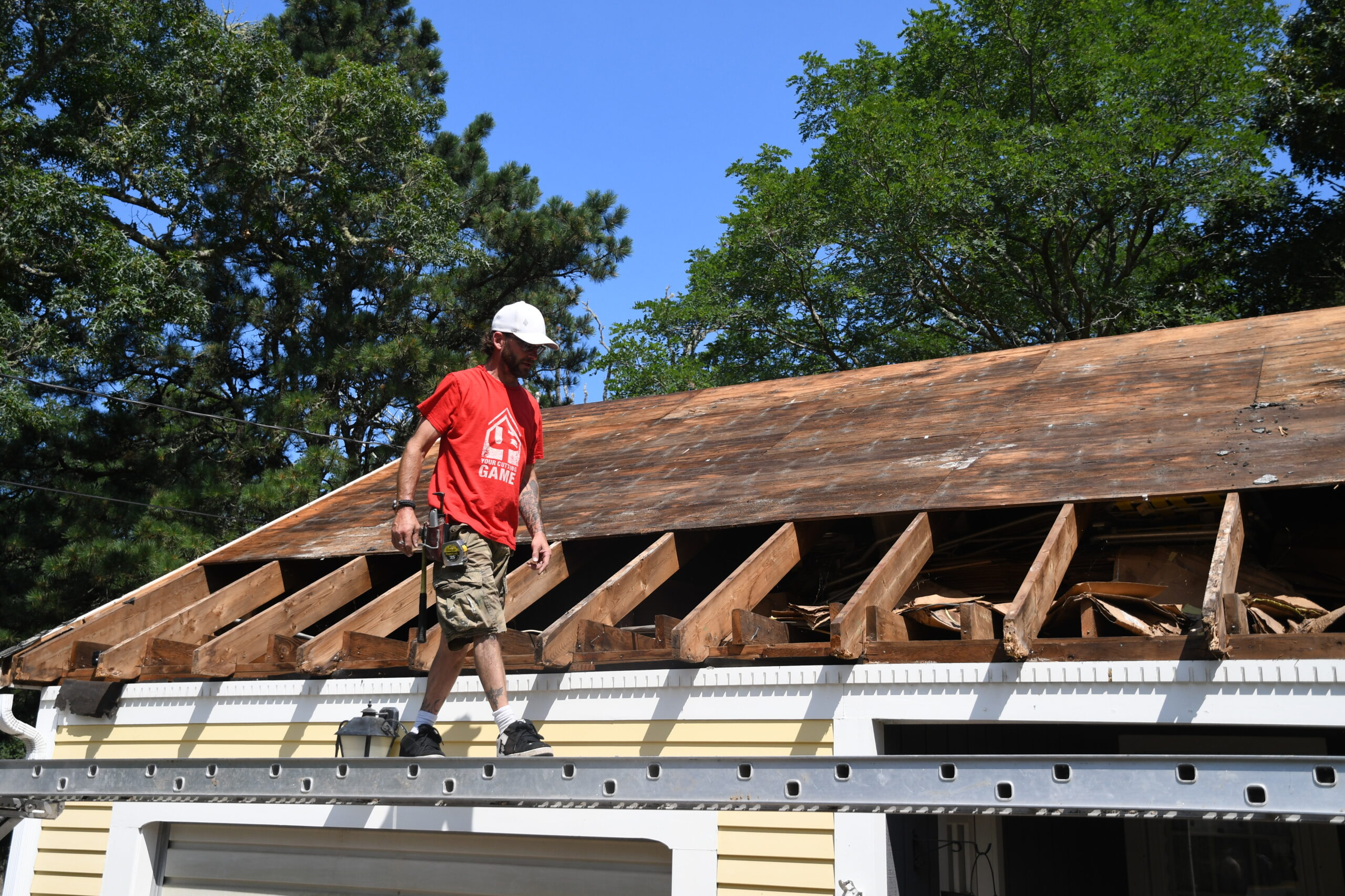 A worker helps fix a roof on a home in Orleans as part of the 2021 Big Fix.