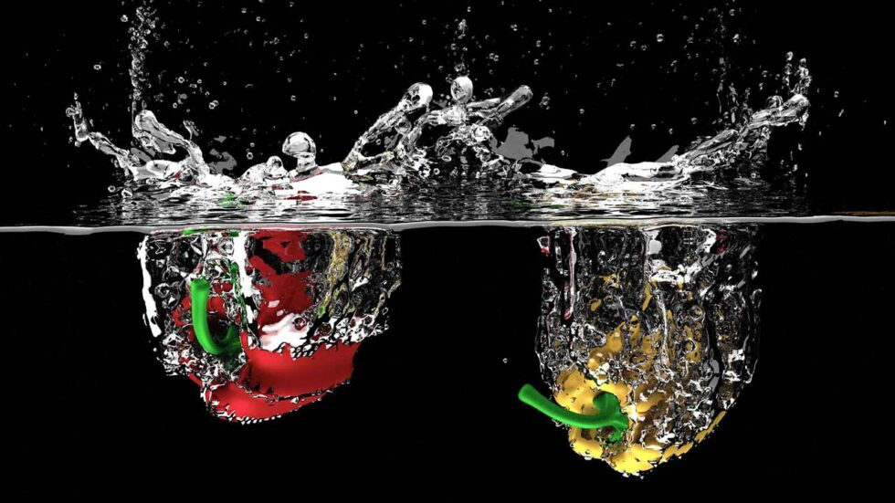 red and yellow pepper splashing into water