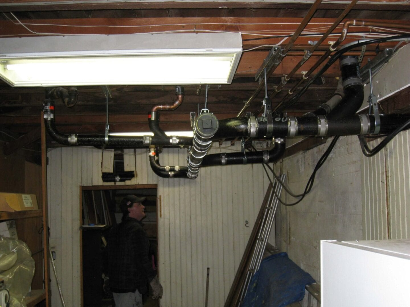 A plumbing contractor checking an installation in San Jose, CA