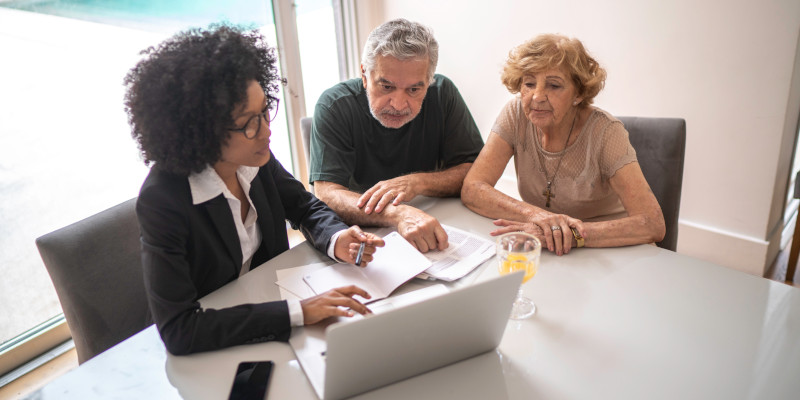 Financial advisor helping a senior couple at home