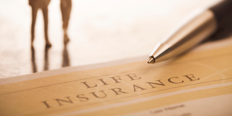 """""""Document entitled life insurance, a pen and a defocused silhouette of a couple on background. Close up image. This is an exclusive image and it can only be found in iStockphoto.  ++Note: The document title is designed by me ++"""""""