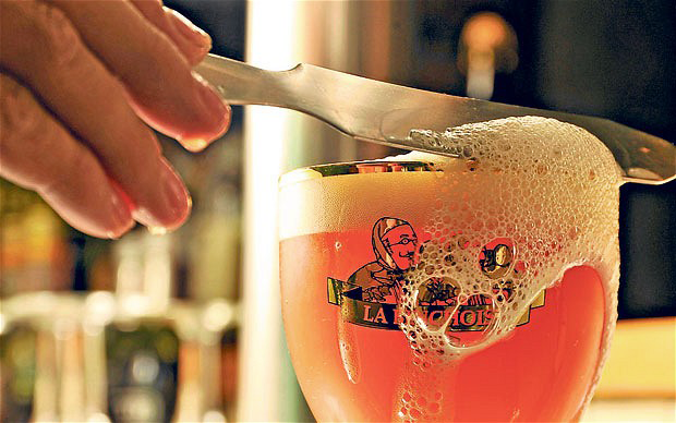 Belgian Beer With Head Being Cut