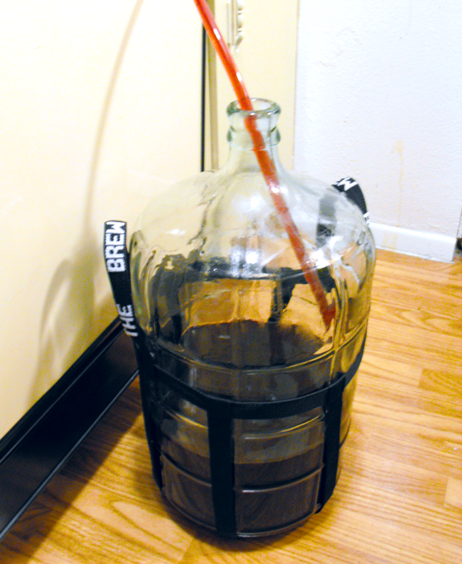 Carboy Being Filled With Wine