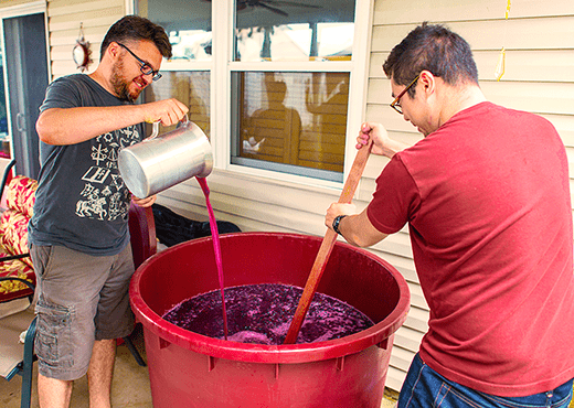 Adding Wine Making Ingredients To A Batch Of Wine.