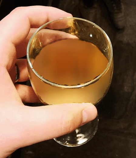Holding A Glass Of Cloudy Mead