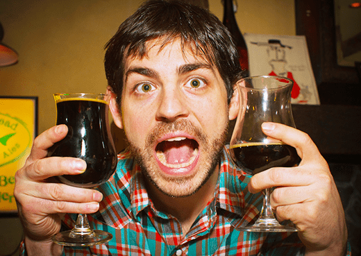 Man Holding Two Glasses Of Ninkasi Brewing Double Latte